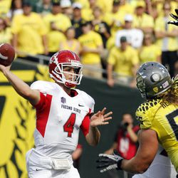 Fresno State quarterback Derek Carr throws against Oregon defender Isaac Remington during the first half of an NCAA college football game in Eugene, Ore., Saturday, Sept. 8, 2012.