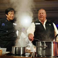 """In this photo taken on Tuesday, Sept. 18, 2012, and released by the Family Reach Foundation, chefs Ming Tsai, left, and Mario Battali participate in """"Cooking Live With Chef Ming Tsai and Friends"""" to benefit the Family Reach Foundation and it's mission to help families fighting pediatric cancer in New York."""