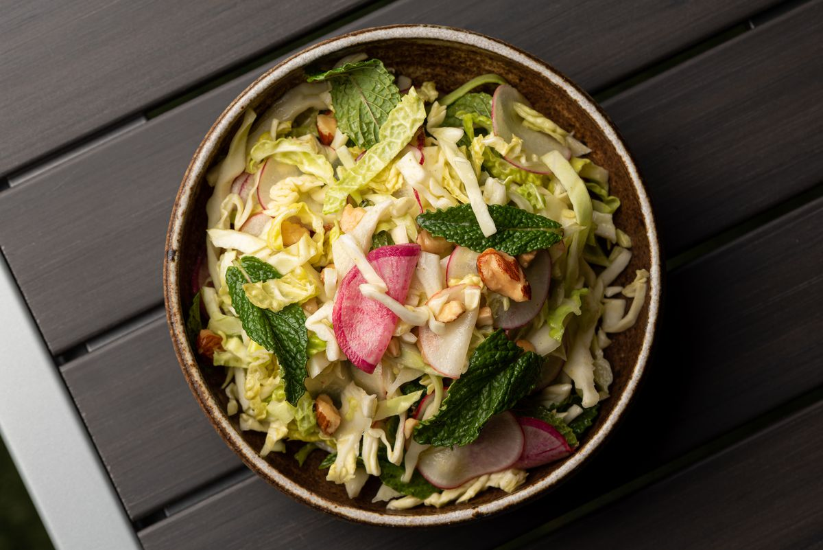 A cabbage salad shown from overhead in a bowl.