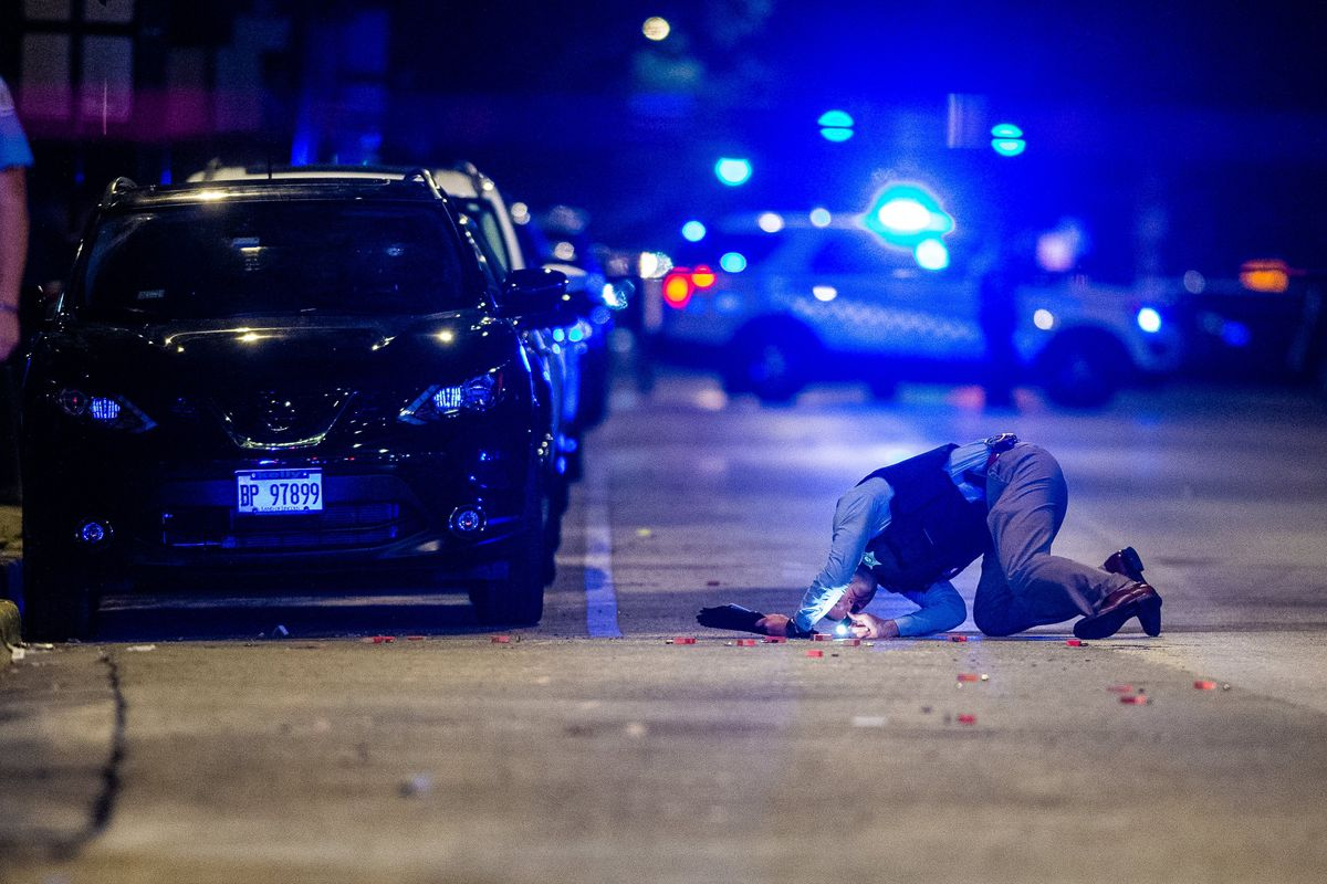 Chicago police investigate the scene where four people were shot Sept. 2, 2019, in the 6200 block of South King Drive.