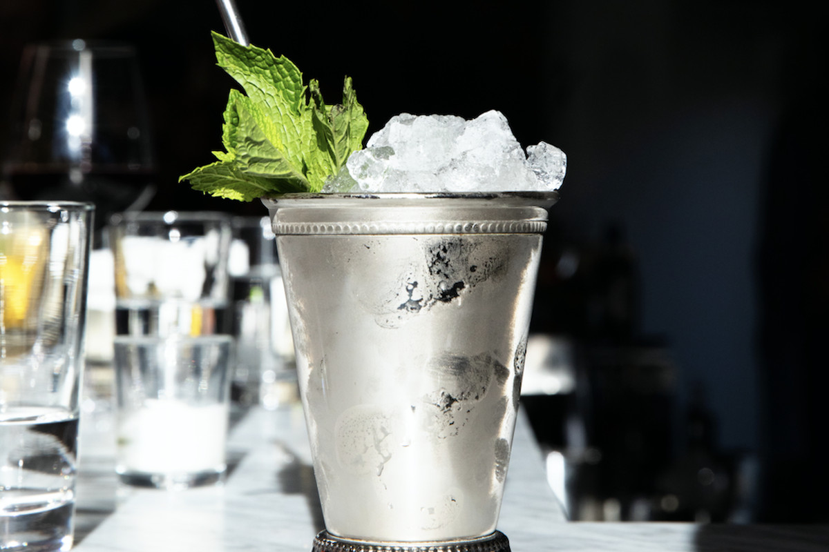 A mint julep in a sterling silver glass at Seattle cocktail bar Baker's