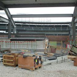 Underneath the left-field bleachers -