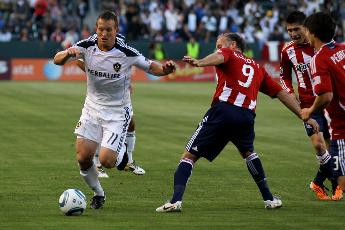 CARSON, CA - MAY 21:  Chad Barrett #11 of the Los Angeles Galaxy controls the ball against Simon Elliott #9 of  Chivas USA at The Home Depot Center on May 21, 2011 in Carson, California.   (Photo by Stephen Dunn/Getty Images)