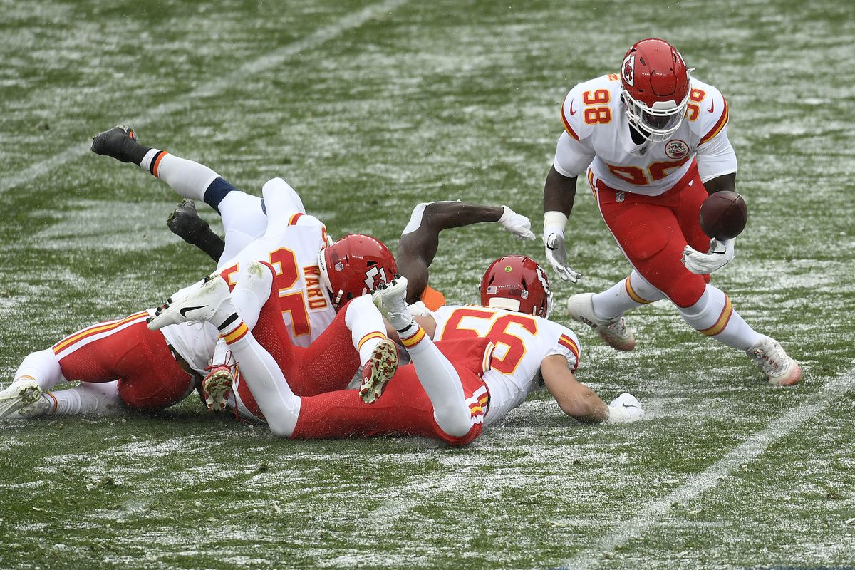 Denver Broncos Melvin Gordon III #25, fumbles the ball in the first quarter as Kansas City Chiefs' defensive tackle Tershawn Wharton tried to get it during the game against the Kansas City Chiefs at Empower Field at Mile High on October 25, 2020 in Denver, Colorado.