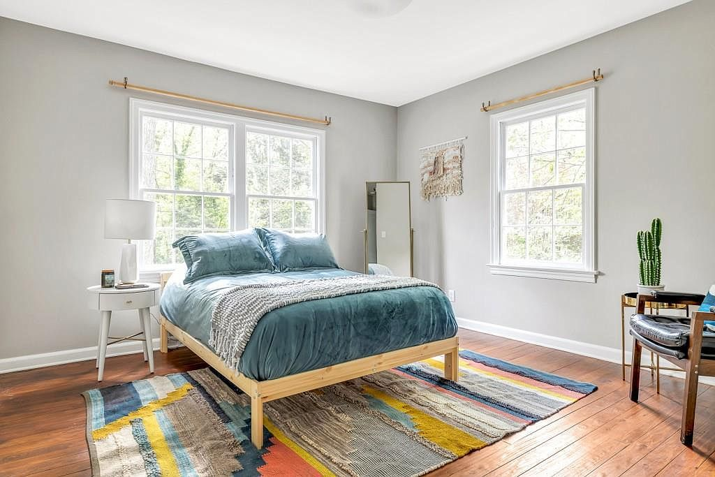 A great master bedroom with a blue bed.