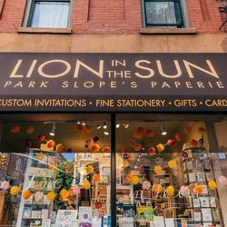 """<b>↑</b> <a href=""""http://lioninthesunps.com/"""">Lion in the Sun</a></b> (232 Seventh Avenue) is your go-to for all things that are pretty and paper. Stop in to browse and pick up cards and stationery that you won't find anywhere else, or set up a meeting to"""