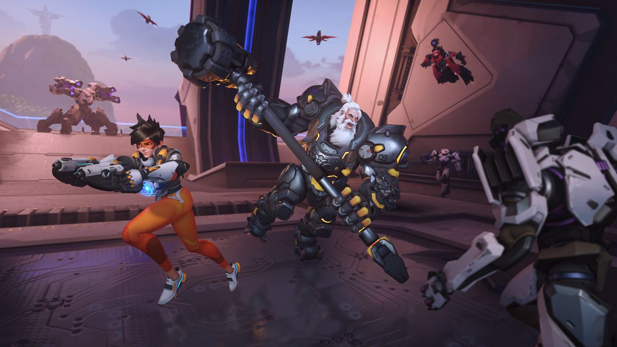 Reinhardt and Tracer battle Omnics in a screenshot from Overwatch 2