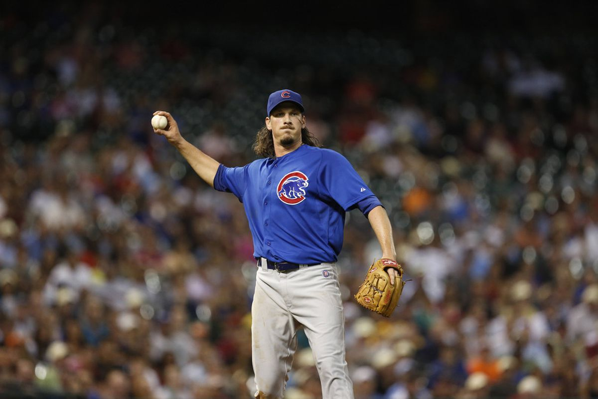 Houston, TX, USA; Chicago Cubs starting pitcher Jeff Samardzija throws out a runner against the Houston Astros at Minute Maid Park. Credit: Thomas Campbell-US PRESSWIRE