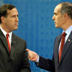 FILE - In this Oct. 12, 2006 file photo, then-Sen. Rick Santorum, R-Pa., left, and his opponent Democrat Bob Casey confront each other during the taping of a debate at the KDKA television studio in Pittsburgh. Republican presidential candidate Rick Santorum is as unpopular in Pennsylvania today as he was six years ago, when home-state voters kicked him out of the Senate in a rout. That sour public perception may doom his fading chances of sticking around in the GOP presidential race, along with other hurdles that dot his path to a possible, and needed, victory in the April 24 primary.