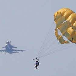 Space Shuttle Endeavour, mounted on NASA's Shuttle Carrier Aircraft (SCA), flies near parasailers in Santa Monica, Calif., Friday, Sept. 21, 2012.