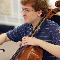 Gifted Music School orchestra student Andrew Yavornitzky practices in Salt Lake City on April 13.