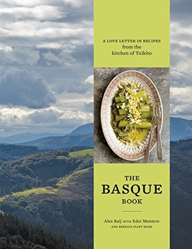 A cookbook with a picture of the Basque country on the cover.