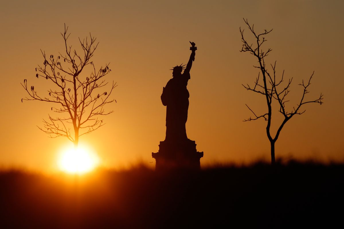 Sunrise and the Statue of Liberty in New York City