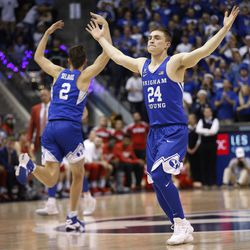 Brigham Young Cougars guards McKay Cannon (24) and Zac Seljaas (2) celebrate the win over Utah in Provo on Saturday, Dec. 16, 2017. BYU won 77-65.