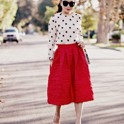 """Hallie of <a href=""""http://www.halliedaily.com""""target=""""_blank"""">Hallie Daily</a> is wearing a Kate Spade top, a Vivian Chan skirt, an <a href=""""http://us.asos.com/aldo/aldo-frame-perfume-bottle-clutch-bag-with-chain-shoulder-strap/prod/pgeproduct.aspx?iid=45"""