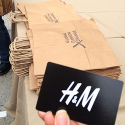 Once closet castoffs are weighed and accepted, staffers handed up shopping bags and—a bonus!—H&M discount cards.