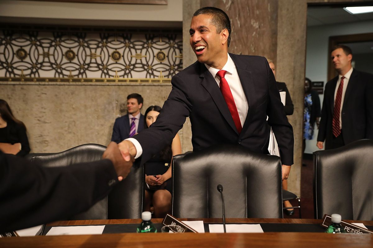 FCC Chairman Ajit Pai shakes hands at his confirmation hearing.
