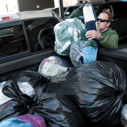 Check City employee Wyatt Beck delivers coats collected during the company's Warm Hearts Coat Drive to the men's resource center in South Salt Lake on Tuesday, Dec. 3, 2019.