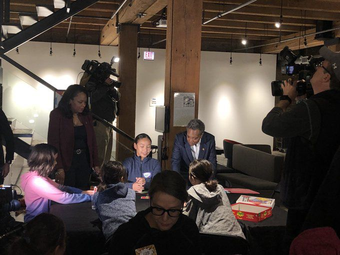 Chicago Mayor Lori Lightfoot, center, and schools chief Janice Jackson visit Marwen youth arts center, which is providing care and meals for schoolchildren during the teachers strike, on Oct. 22, 2019.