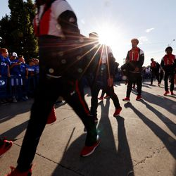 Utah players walk past BYU fans who are booing them as they arrive for an NCAA football game at LaVell Edwards Stadium in Provo on Saturday, Sept. 11, 2021.