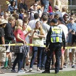 A sheriff's deputy talks to students behind police barrier on the Norlin Quad at the University of Colorado in Boulder, Colo., on Friday, April 20, 2012, at 4:20pm. Police blocked off the quad to prevent a 420 marijuana smoke out.