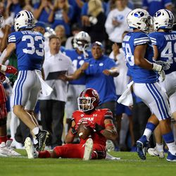 Utah Utes running back Micah Bernard (2) sits up after being hit by Brigham Young Cougars linebacker Ben Bywater (33) as BYU and Utah play an NCAA football game at LaVell Edwards Stadium in Provo on Saturday, Sept. 11, 2021. BYU won 26-17, ending a nine-game losing streak to the Utes.