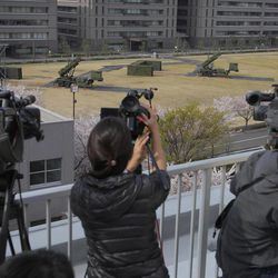 Cameramen stand by to cover the PAC-3 surface to air missile units at the Defense Ministry in Tokyo, Japan, Friday, April 13, 2012. North Korea fired a long-range rocket early Friday, South Korean defense officials said, defying international warnings against a launch widely seen as a provocation.