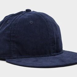 """<strong>Saturdays Surf NYC</strong> Corduroy Rich Fitted Cap in Deep Blue, <a href=""""http://www.saturdaysnyc.com/item/corduroy-rich-fitted"""">$40</a>"""