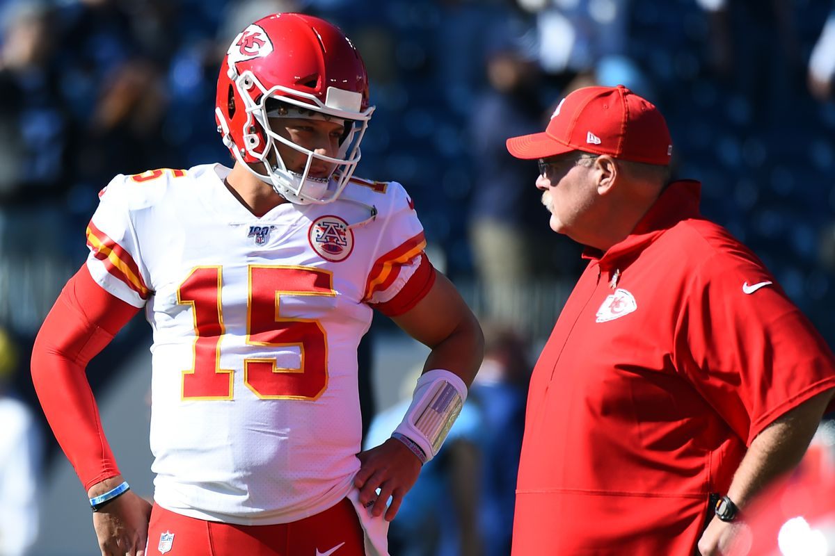 Kansas City Chiefs quarterback Patrick Mahomes talks with head coach Andy Reid before a game against the Tennessee Titans at Nissan Stadium.
