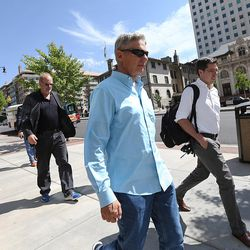 Libertarian presidential candidate Gov. Gary Johnson walks toward City Creek Center as he and running mate Gov. Bill Weld look for lunch in Salt Lake City prior to giving a speech at the University of Utah on Saturday, Aug. 6, 2016.