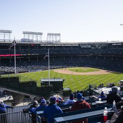 Fans watch the Chicago Cubs Opening Day game against the Pittsburgh Pirates from the Wrigley Rooftops.