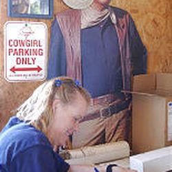 Erin Clelland completes paperwork at the Weber auction yard.