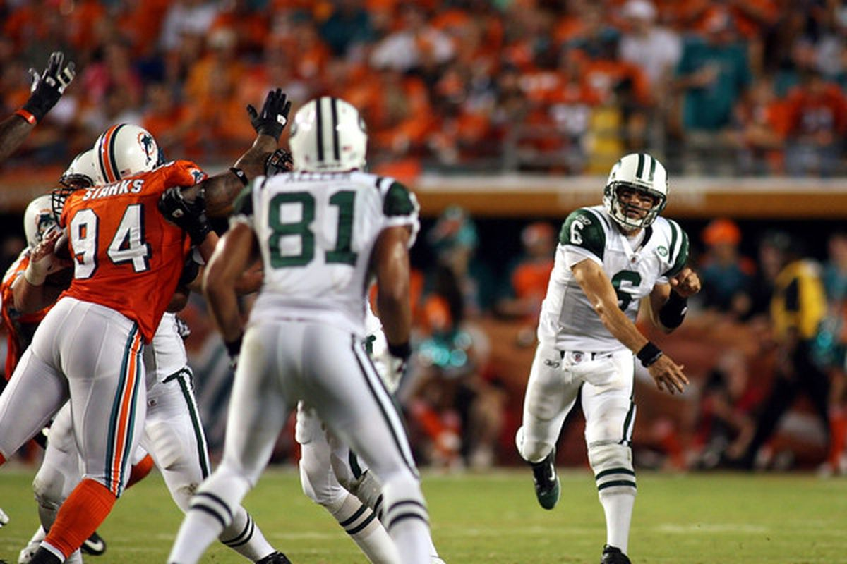 MIAMI - SEPTEMBER 26:  Quarterback Mark Sanchez #6 of the New York Jets throws against the Miami Dolphins at Sun Life Stadium on September 26 2010 in Miami Florida.  (Photo by Marc Serota/Getty Images)