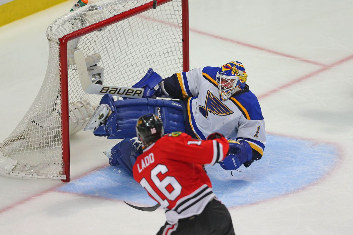 Brian Elliott makes a save against Andrew Ladd
