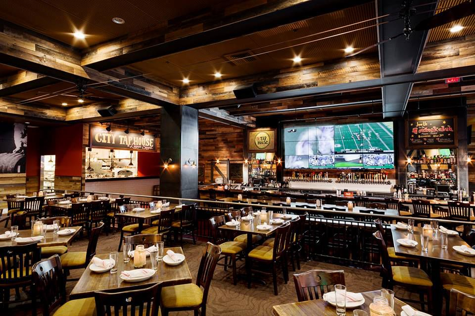 restaurant with big screen TV over the bar showing football