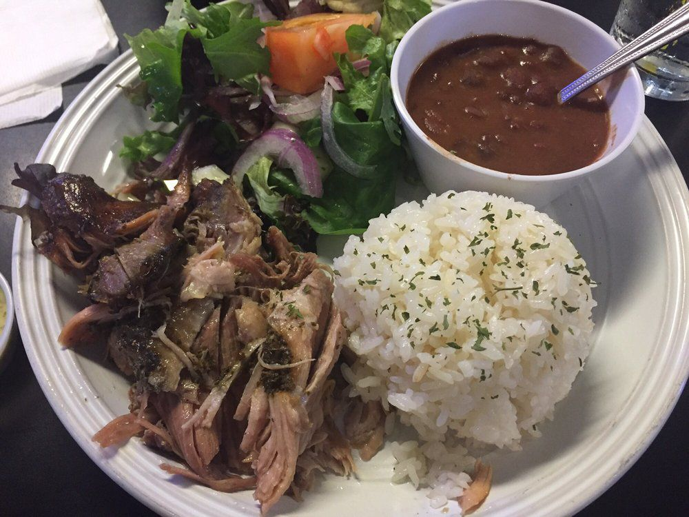 Pernil with white rice and red beans at Chago's Caribbean Cuisine