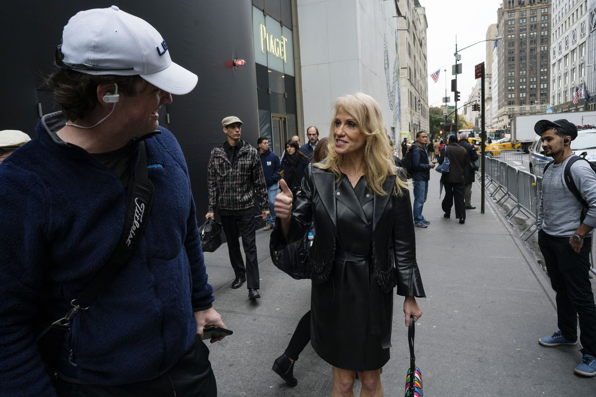 Kellyanne Conway, campaign manager for President-elect Donald Trump, pauses to speak to passersby across form Trump Tower in New York Wednesday, Nov. 9, 2016.