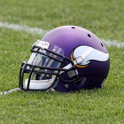 Jul 26, 2013; Mankato, MN, USA; Minnesota Vikings helmet sits in the grass during training camp at Minnesota State University. Mandatory Credit: Brace Hemmelgarn-USA TODAY Sports