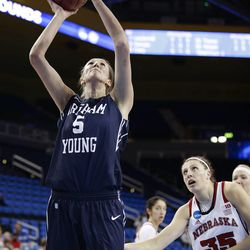 BYU's Jennifer Hamson (5) puts up a shot as Nebraska's Jordan Hooper (35) watches during the first half of a second-round game in the NCAA women's college basketball tournament on Monday, March 24, 2014, in Los Angeles. (AP Photo/Jae C. Hong)