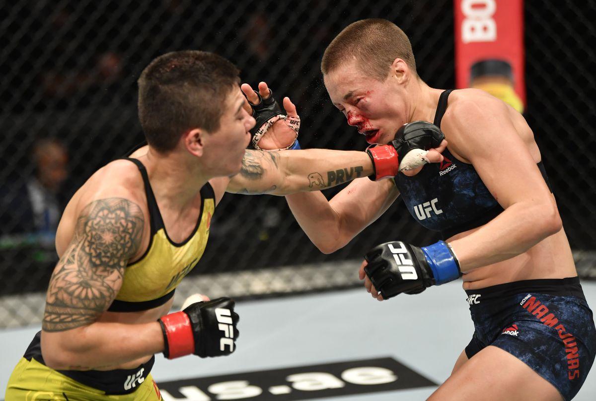 Jessica Andrade lands a left hook on Rose Namajunas at UFC 251.