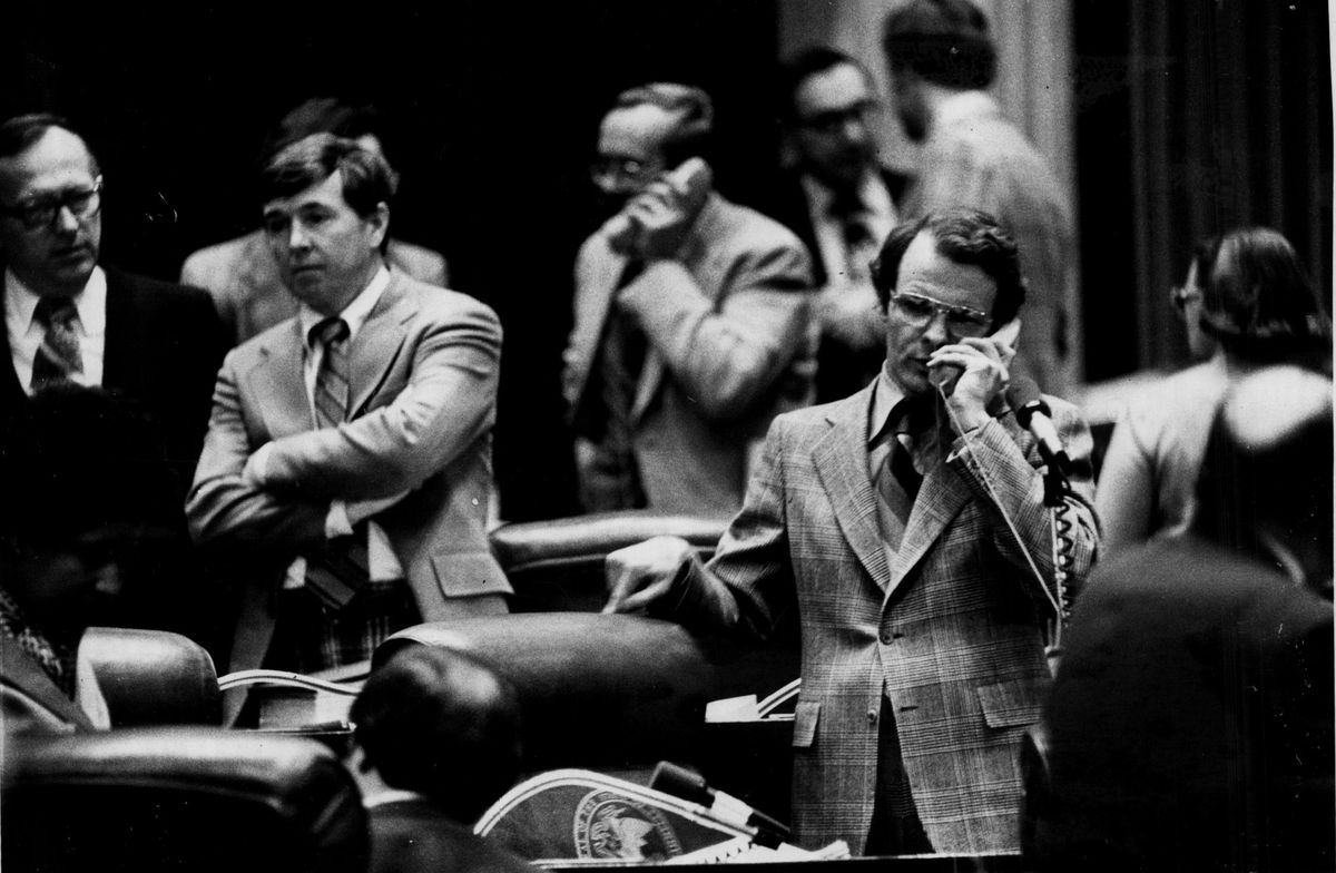 State Rep. Mike Madigan, right, talks on the telephone during House session in 1979.