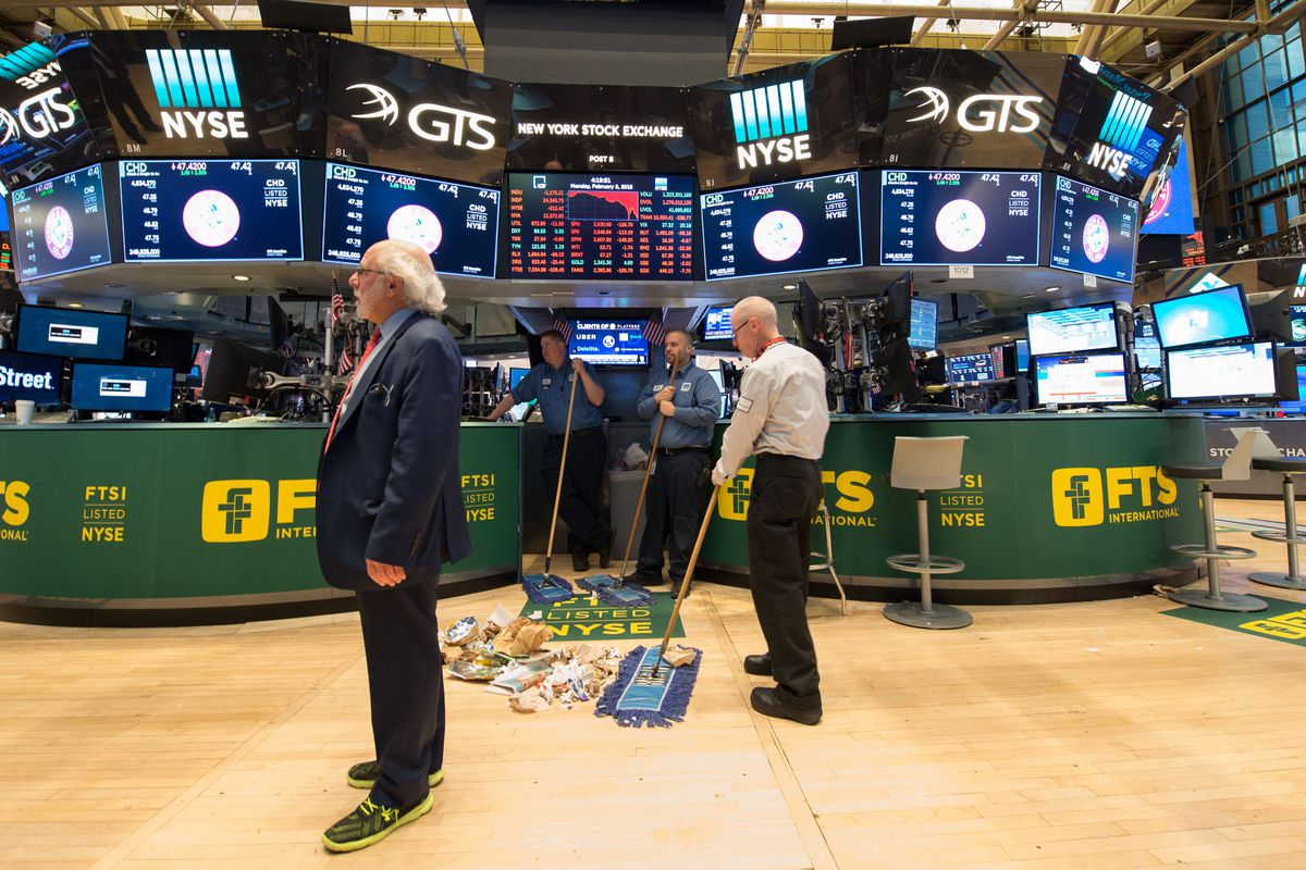 sweeping up after the closing bell of the Dow Industrial Average at the New York Stock Exchange. Wall Street stocks endured a brutal session Monday, with the Dow seeing one of its steepest ever one-day point drops.