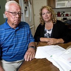 A pile of paperwork regarding a fraud case clutters the dining room table in Suzanne Rengers' home in West Jordan on Tuesday, Sept. 27, 2016. Rengers and her father, Frank Arnold Horton, say they were both scammed by their tax preparer and financial manager,