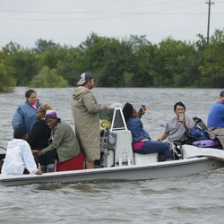 Volunteers rescue stranded victims during Tropical Storm Harvey in Houston on Tuesday, Aug. 29, 2017.