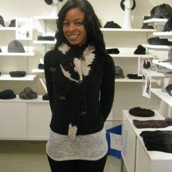Sales associate looking Foxy wearing the scarf.