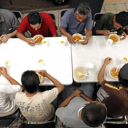 Dozens of men, many of them Mexican citizens, eat a modest dinner at a well known immigrant shelter, as many are making tough decisions on whether to try their luck at trying to make it to the United States, by illegally crossing the border, Thursday, Aug. 9, 2012, in Nogales, Mexico.  The U.S. government has halted flights home for Mexicans caught entering the country illegally in the deadly summer heat of Arizona's deserts, a money-saving move that ends a seven-year experiment that cost taxpayers nearly $100 million.