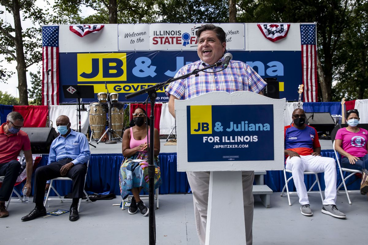 Gov. J.B. Pritzker speaks during Governor's Day at the Illinois State Fair on the Director's Lawn in Springfield on Wednesday.