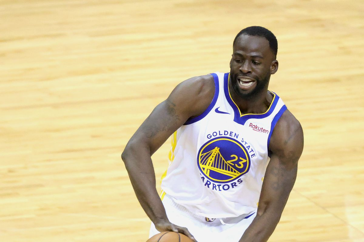 Golden State Warriors forward Draymond Green controls the ball against the Houston Rockets during the first quarter at Toyota Center.