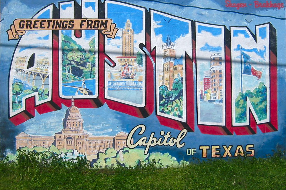 """A mural that looks like a vintage postcard that says """"Greetings From Austin"""""""