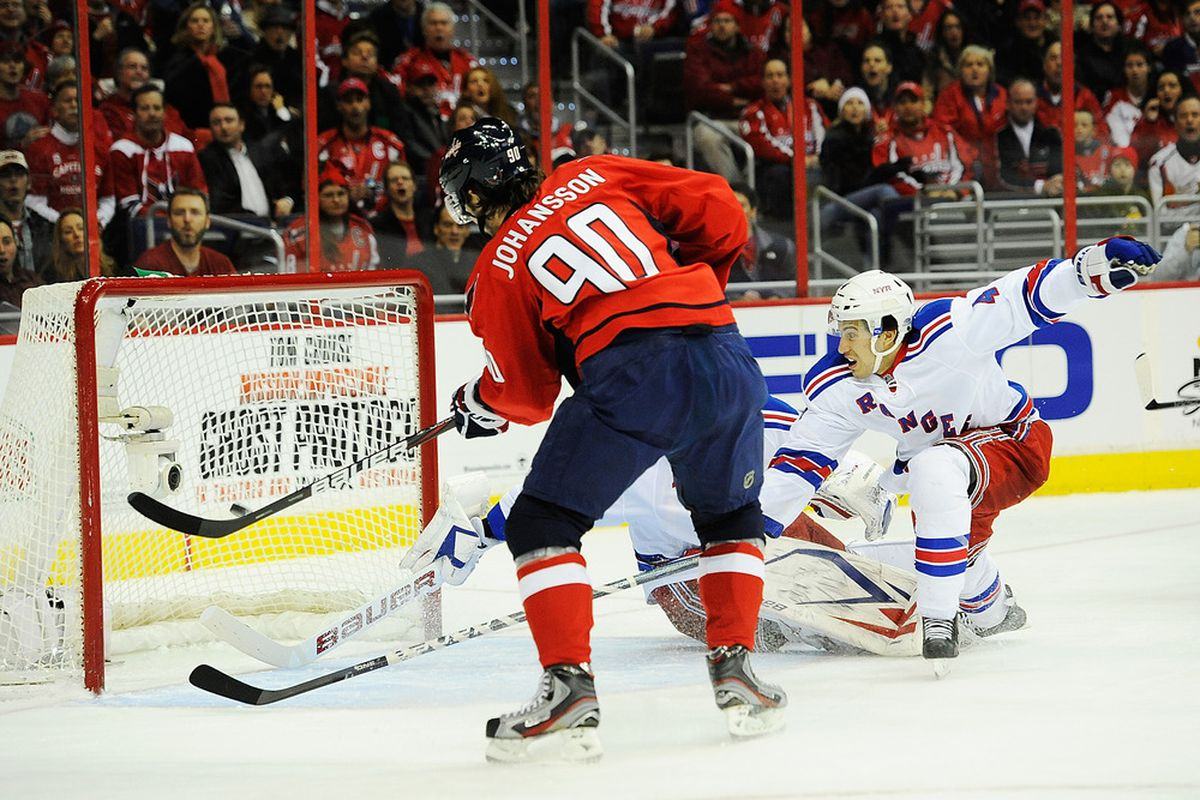WASHINGTON, DC - DECEMBER 28:  Marcus Johansson #90 of the Washington Capitals scores a goal against the New York Rangers during the first period at Verizon Center on December 28, 2011 in Washington, DC.  (Photo by Patrick McDermott/Getty Images)